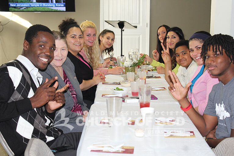 World Mission Society Church of God members and guests at the table during 2015 Mother's Day dinner in Louisville, KY