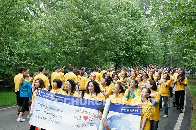 World Mission Society Church of God volunteers walking and cheering during the 2011 Walk Now for Autism Speaks