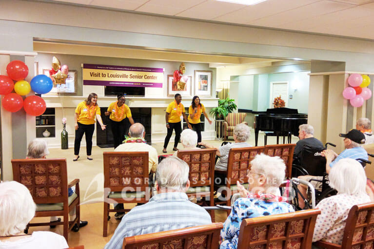 World Mission Society Church of God volunteers performing for the residents of Atria Senior Living